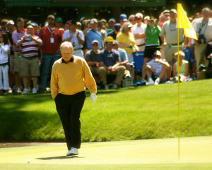 Jack Nicklaus walks up to his ball on the 9th hole of the par-3 course at Augusta National Golf Club 2014.